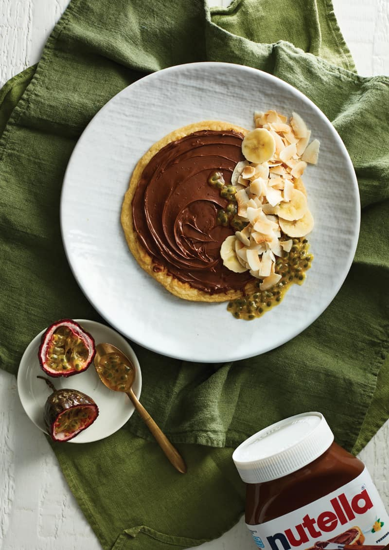Banana Nutella pancakes with passionfruit and coconut